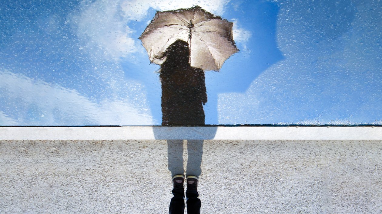 A  girl with umbrella reflected